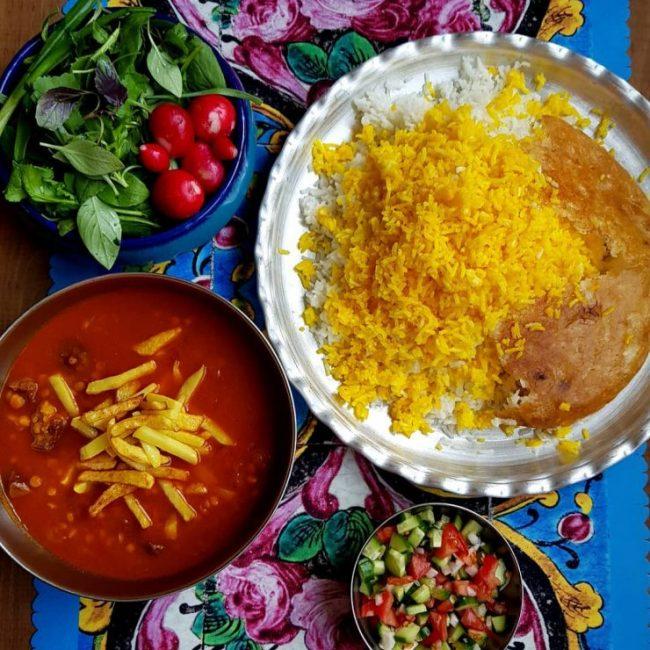Gheimeh, salad shirazi,sabzi khordan, and polow