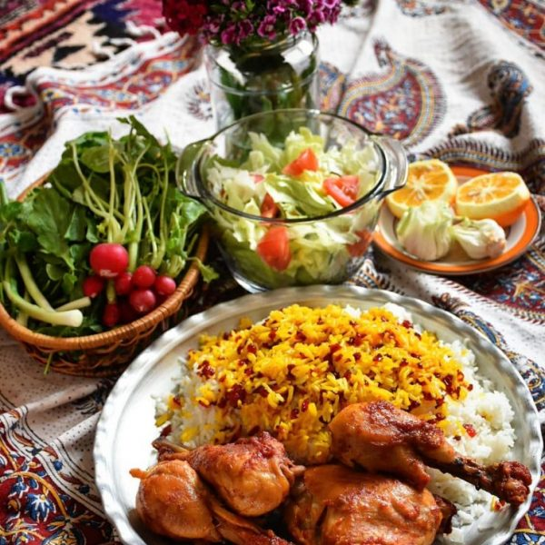 Zereshk Polow Morgh with salad and orange