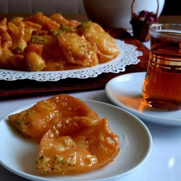 Gosh-e Fil with Tea